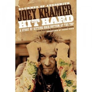 Joey Kramer signs his new memoir.