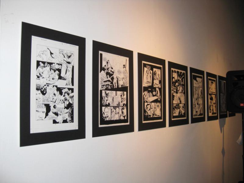 Wall of original art from the series.