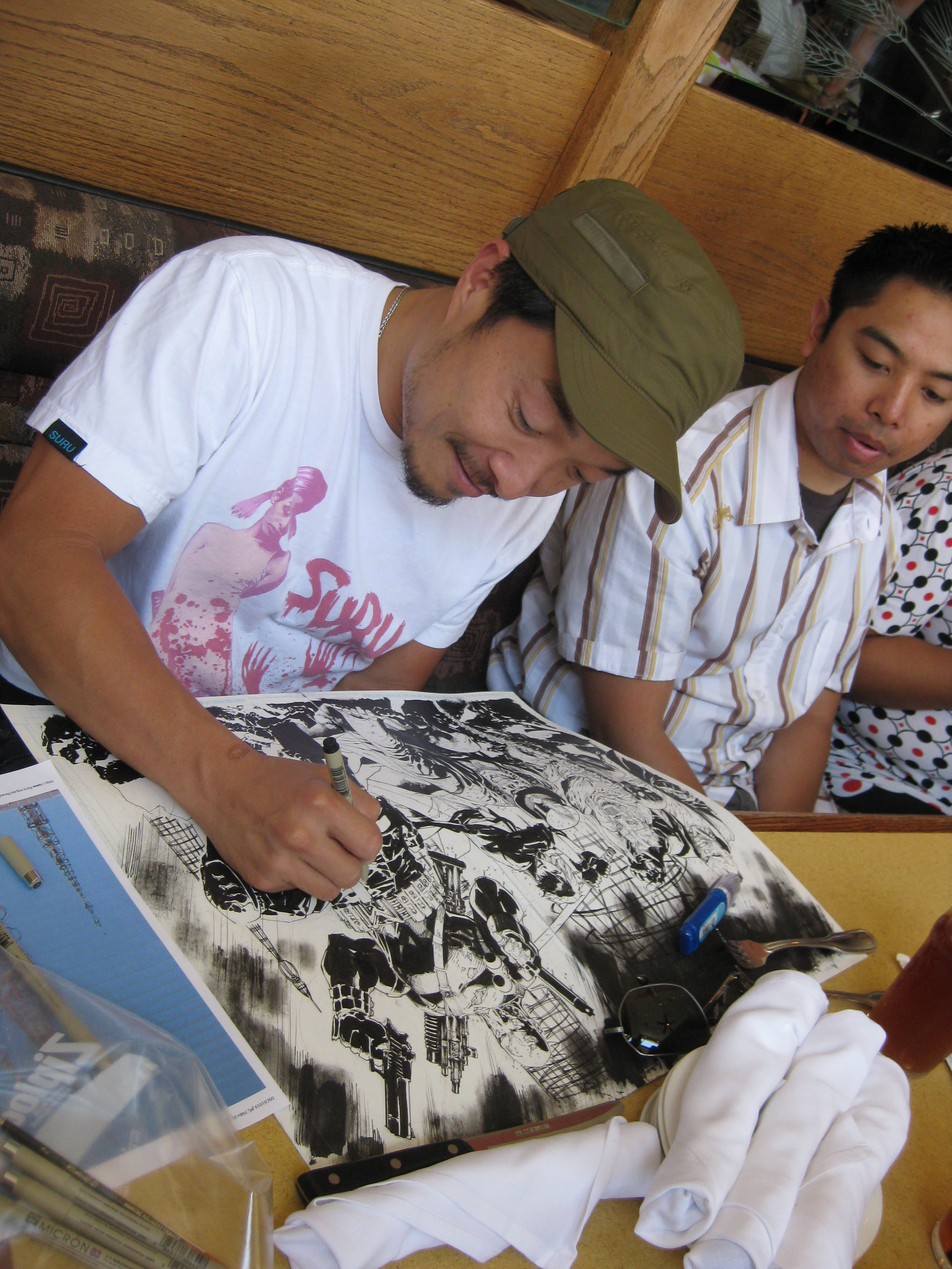 Jim Lee happily drawing the cover to Mayhem's TPB during lunch.