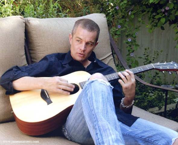 James Marsters playing guitar