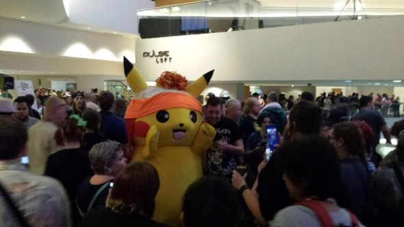 Pikachu takes some pictures with fans.